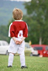 Kind in einer Fussballdress